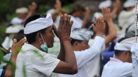 Balinese Hindus take part in a ceremony, where they pray near Mount Agung in hope of preventing a volcanic eruption on November 26.