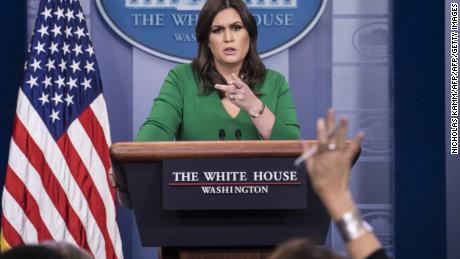 White House spokesperson Sarah Huckabee Sanders speaks during a press briefing at the White House in Washington, DC, on November 16, 2017. / AFP PHOTO / NICHOLAS KAMM        (Photo credit should read NICHOLAS KAMM/AFP/Getty Images)