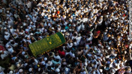 Mourners carry the coffin of Ko Ni, prominent Muslim lawyer who was shot dead on January 29, at the Muslim cemetery in Yangon on January 30, 2017.