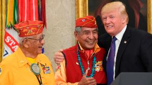 President Donald Trump, right, meets with Navajo Code Talkers Peter MacDonald, center, and Thomas Begay, left, in the Oval Office of the White House in Washington, Monday, Nov. 27, 2017. (AP Photo/Susan Walsh