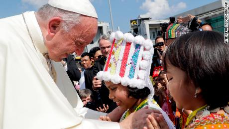 Pope Francis is greeted by young children in traditional clothes upon his arrival at Yangon's airport, Myanmar, Monday, Nov. 27, 2017. The pontiff is in Myanmar for the first stage of a week-long visit that will also take him to neighboring Bangladesh. (AP Photo/Andrew Medichini)