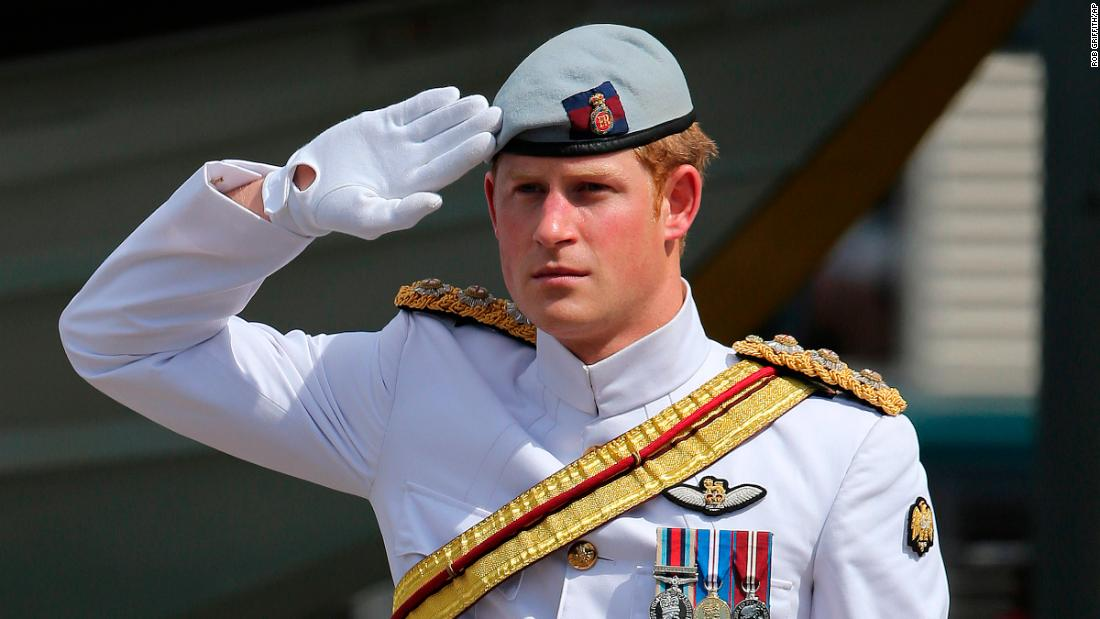 Harry receives a royal salute from the honor guard at the Garden Island naval base in Sydney in 2013.
