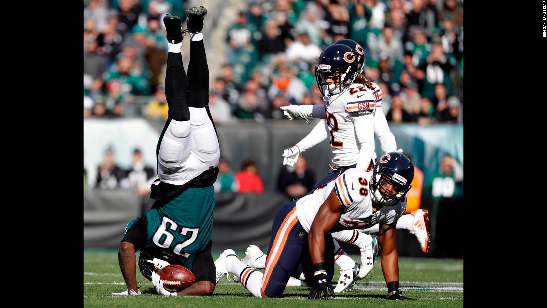 Philadelphia running back LaGarrette Blount is upended by Chicago's Adrian Amos, lower right, during an NFL game in Philadelphia on Sunday, November 26.