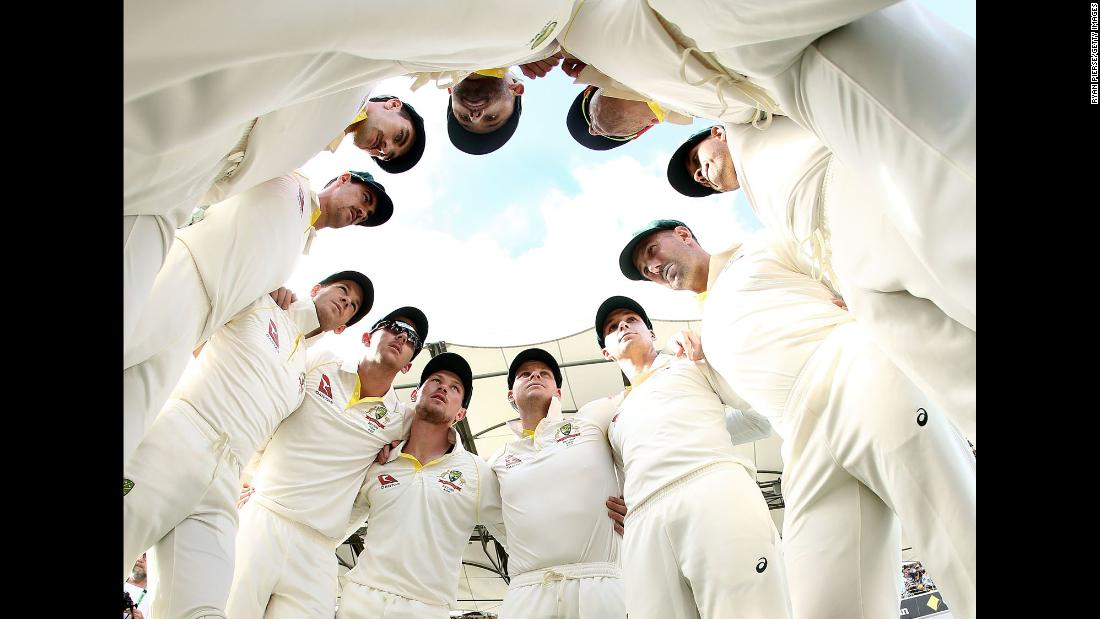 Australia's cricket team huddles up before taking the field against England on Saturday, November 25. Australia won the first Test match of the latest Ashes series. The second match starts Friday.