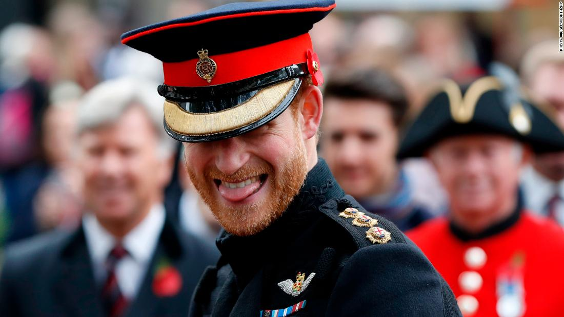 Harry smiles as he speaks to veterans in London in November. He was attending the official opening ceremony of the Field of Remembrance at Westminster Abbey.