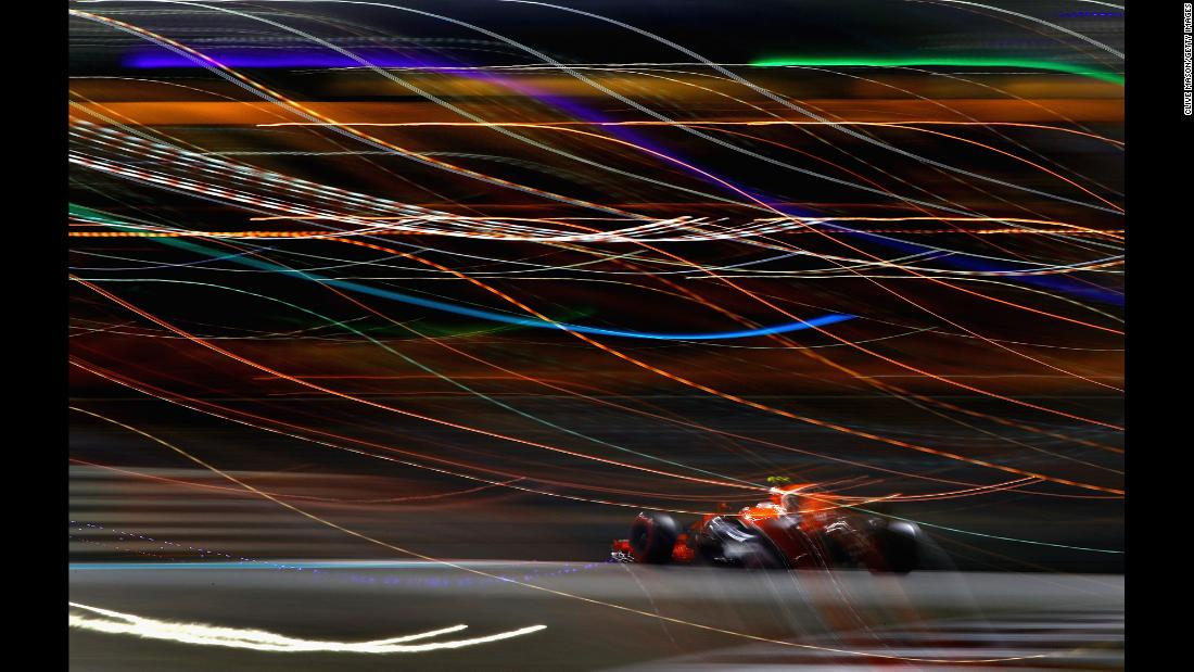 In this photo, taken using a slow shutter speed, Formula One driver Stoffel Vandoorne competes in the Abu Dhabi Grand Prix on Sunday, November 26.