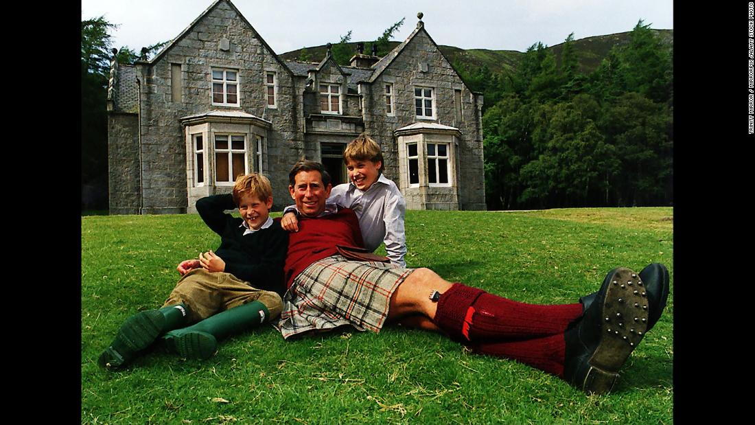 Prince Charles and his sons pose outside a country house circa 1990.