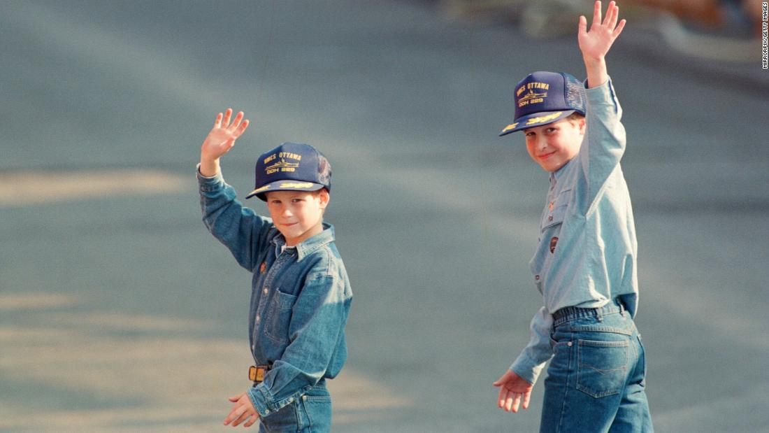 Harry, left, and William wave to the cameras during a 1991 tour of Canada. The caps were given to them by the crew of the Canadian frigate HMCS Ottawa.