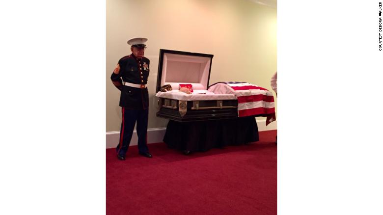 Cox stands guard at  Hollingsworth's casket.