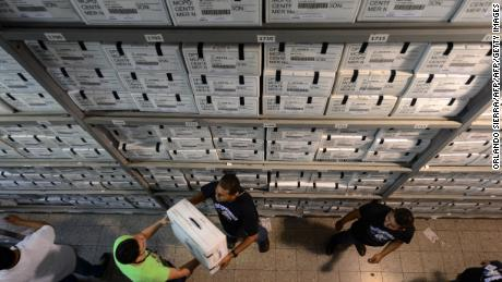 Civil servants handle electoral boxes containing the ballots for the November 24 general election, on November 18, 2013 in Tegucigalpa   AFP PHOTO / Orlando SIERRA.        (Photo credit should read ORLANDO SIERRA/AFP/Getty Images)
