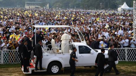 Pope Francis waves to Myanmar Catholic well wishers prior to an open air mass in Yangon on November 29, 2017.