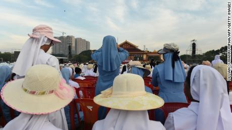 Nuns take photos prior to an open air mass by pope Francis in Yangon.
