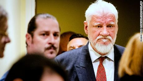 Slobodan Praljak enters the Yugoslav War Crimes Tribunal in The Hague, Netherlands on Wednesday.