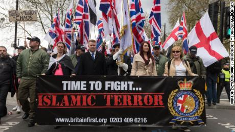 Leaders of Britain First Jayda Fransen, second from right, and Paul Golding, third from left, lead a march in London on April 1, 2017.