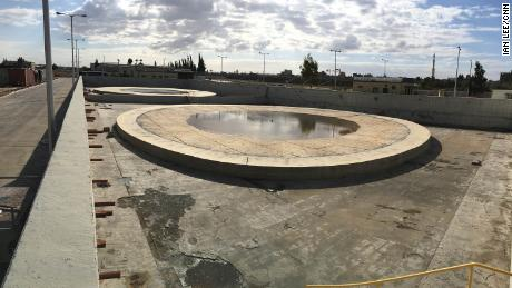 Two cement pads are all that's left after fuel storage tanks at Gaza's power plant were destroyed by Israeli airstrikes in 2014.