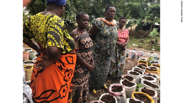 Women in the Kipunguni program stand in their community garden.