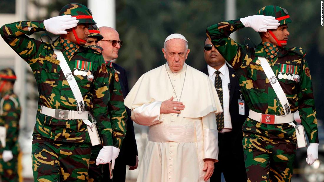 Pope Francis passes members of the honor guard as he arrives at Dhaka's international airport in Bangladesh on November 30.