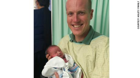 Cop adopts homeless addict's newborn baby