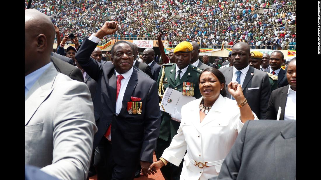 "Zimbabwe's interim President, Emmerson Mnangagwa, greets the crowd during his oath-taking ceremony in Harare, Zimbabwe, on Friday, November 24. <a href=""http://www.cnn.com/2017/11/24/africa/mnangagwa-swearing-in-zimbabwe/index.html"" target=""_blank"">Mnangagwa was sworn in</a> following the historic resignation of Robert Mugabe, who led the African country for nearly four decades. Mnangagwa served as Mugabe's right-hand man for most of his career, but he used his first official address to try and differentiate himself from his predecessor."