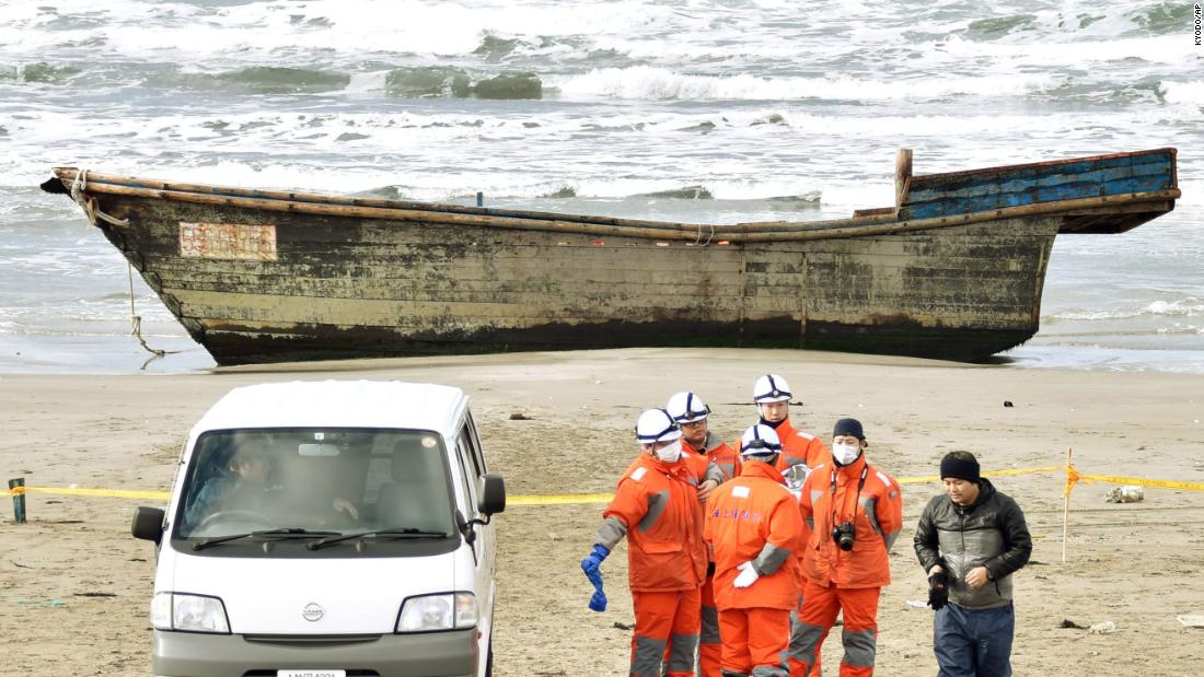 "Officials gather Tuesday, November 27, near an unidentified wooden boat that washed ashore in Oga, Japan, with eight dead bodies on board. At least four ships <a href=""http://www.cnn.com/2017/11/28/asia/north-korea-japan-ship/index.html"" target=""_blank"">have washed up on Japan's west coast</a> in November, some with bodies on board. And while authorities haven't confirmed their origin, signs suggest they're from North Korea."
