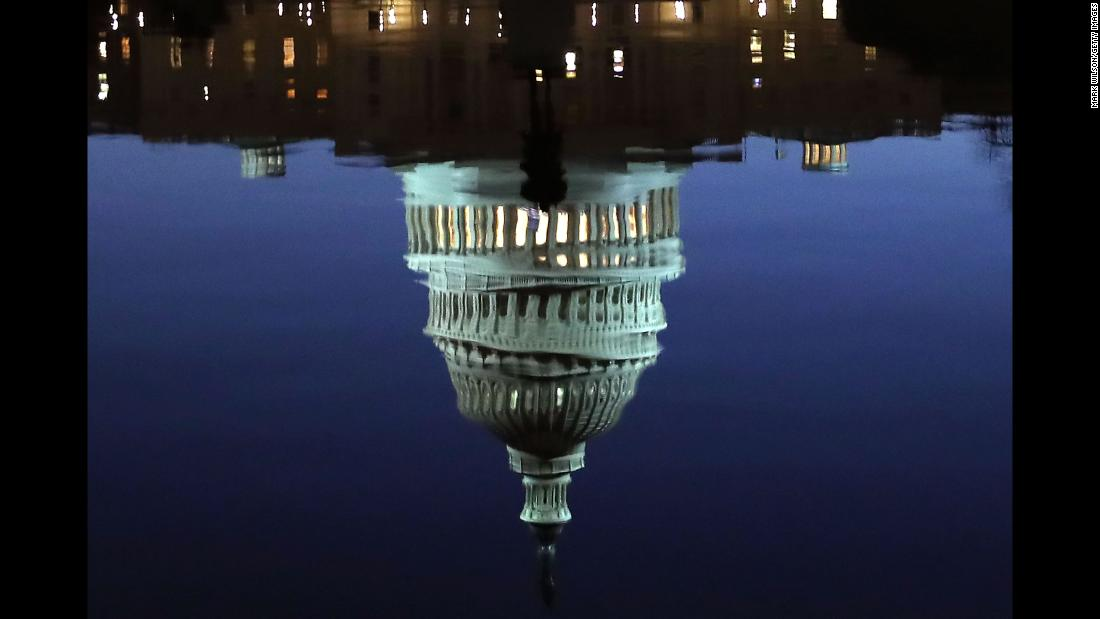 "A reflection of the US Capitol is seen in Washington on Wednesday, November 29. <a href=""http://www.cnn.com/2017/11/23/world/gallery/week-in-photos-1124/index.html"" target=""_blank"">See last week in 32 photos</a>"