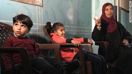 Three-year-old Feras Al Dan with his mother and sister at home in Gaza City