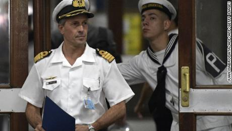 "Argentine Navy spokesman, Captain Enrique Balbi arrives to deliver a press conference at the Navy headquarters in Buenos Aires, on November 23, 2017. An unusual noise heard in the ocean near the last known position of the San Juan submarine was ""consistent with an explosion,"" Argentina's navy announced Thursday. ""An anomalous, singular, short, violent and non-nuclear event consistent with an explosion,"" occurred shortly after the last communication of the San Juan and its 44 crew, navy spokesman Captain Enrique Baldi told a news conference in Buenos Aires.  / AFP PHOTO / JUAN MABROMATA        (Photo credit should read JUAN MABROMATA/AFP/Getty Images)"