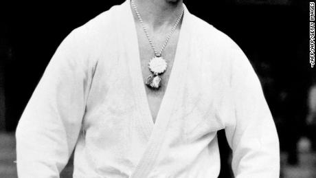 Anton Geesink from Netherlands, poses wearing the gold medal he won in the Judo Open event at the Olympic Games in Tokyo, October 1964.  World champion in 1961 and 1965 the giant (2-metre) Dutchman won the European title for individuals 13 times. / AFP PHOTO / -        (Photo credit should read -/AFP/Getty Images)
