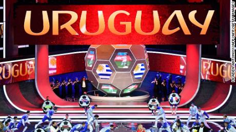 "Artists perform on stage as ""Uruguay"" is displayed on screens during the Final Draw for the 2018 FIFA World Cup football tournament at the State Kremlin Palace in Moscow on December 1, 2017.  The 2018 FIFA World Cup will be held from June 14 and July 15, 2018, in 11 Russian cities. / AFP PHOTO / Mladen ANTONOV        (Photo credit should read MLADEN ANTONOV/AFP/Getty Images)"