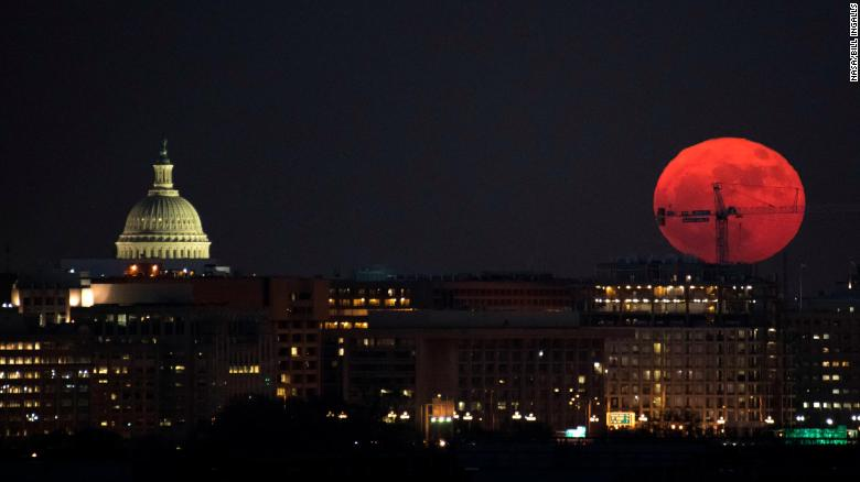 A supermoon is seen rising over Washington DC on December 3, 2017.
