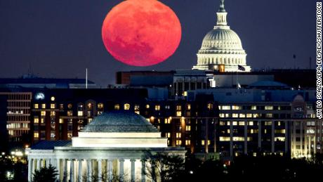 A so-called 'supermoon' rises behind the US Capitol (R) and the Jefferson Memorial (bottom), in Washington, DC, viewed from Arlington, Virginia, USA, 03 December 2017. A supermoon occurs when a full moon coincides with the point at which the moon's orbit is closest to Earth. This is the only supermoon of 2017.