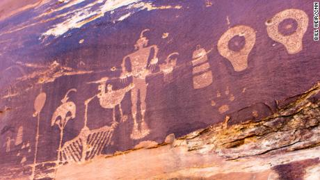 Ancient rock art is pockmarked by bullet holes.