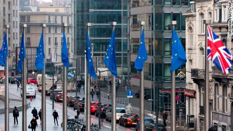 Flags flap in the wind outside the EU headquarters in Brussels on Monday.