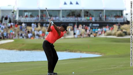 Tiger Woods plays an approach to the 18th green during the final round of the World Hero Challenge.
