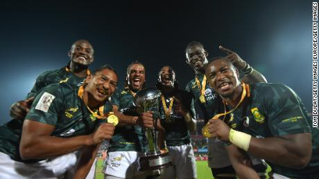 DUBAI, UNITED ARAB EMIRATES - DECEMBER 02:  Players of South Africa pose for photos with the trophy after winning the Cup Final match between South Africa and New Zealand on Day Three of the Emirates Dubai Rugby Sevens - HSBC Sevens World Series at The Sevens Stadium on December 2, 2017 in Dubai, United Arab Emirates.  (Photo by Tom Dulat/Getty Images)