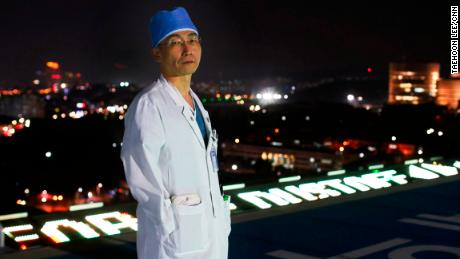 Dr. Lee Cook-Jong on the hospital's rooftop helipad.