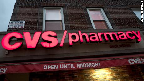 A CVS Pharmacy is open, Sunday, Dec. 3, 2017 in the Brooklyn borough of New York. CVS will buy insurance giant Aetna in a roughly $69 billion deal that will help the drugstore chain reach deeper into customer health care and protect a key client, a person with knowledge of the matter said Sunday. (AP Photo/Mark Lennihan)