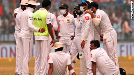 Sri Lanka's cricket team wears anti-pollution masks as they play the second day of their third test match in New Delhi, on Sunday December 3.