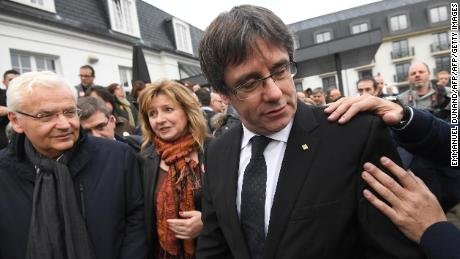 Deposed Catalan leader Carles Puigdemont (R) unites with his fellow candidates after a press conference in Oostkamp, near Brugge, on November 25, 2017 where he announced his candidacy for Catalan regional elections and unveil his electoral list for the December 21 election.  / AFP PHOTO / EMMANUEL DUNAND        (Photo credit should read EMMANUEL DUNAND/AFP/Getty Images)