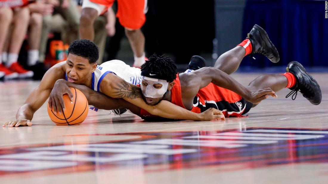 DePaul's Justin Roberts, left, and Youngstown State's Jeremiah Ferguson battle for a loose ball during a college basketball game in Chicago on Saturday, December 2.
