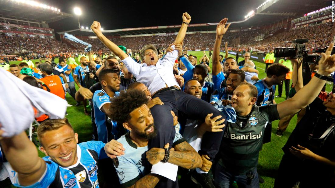 "Gremio players carry their coach, Renato Gaucho, after <a href=""http://www.cnn.com/2017/11/30/football/copa-libertadores-final-gremio-beats-lanus/index.html"" target=""_blank"">winning the Copa Libertadores</a> on Wednesday, November 29. The Brazilian soccer club defeated Argentina's Lanus to be crowned the best soccer club in South America."