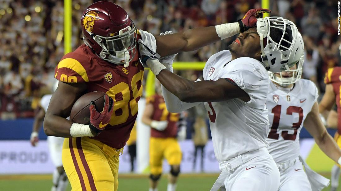 USC tight end Daniel Imatorbhebhe stiff-arms Stanford's Frank Buncom during the Pac-12 championship game on Friday, December 1. USC won 31-28.