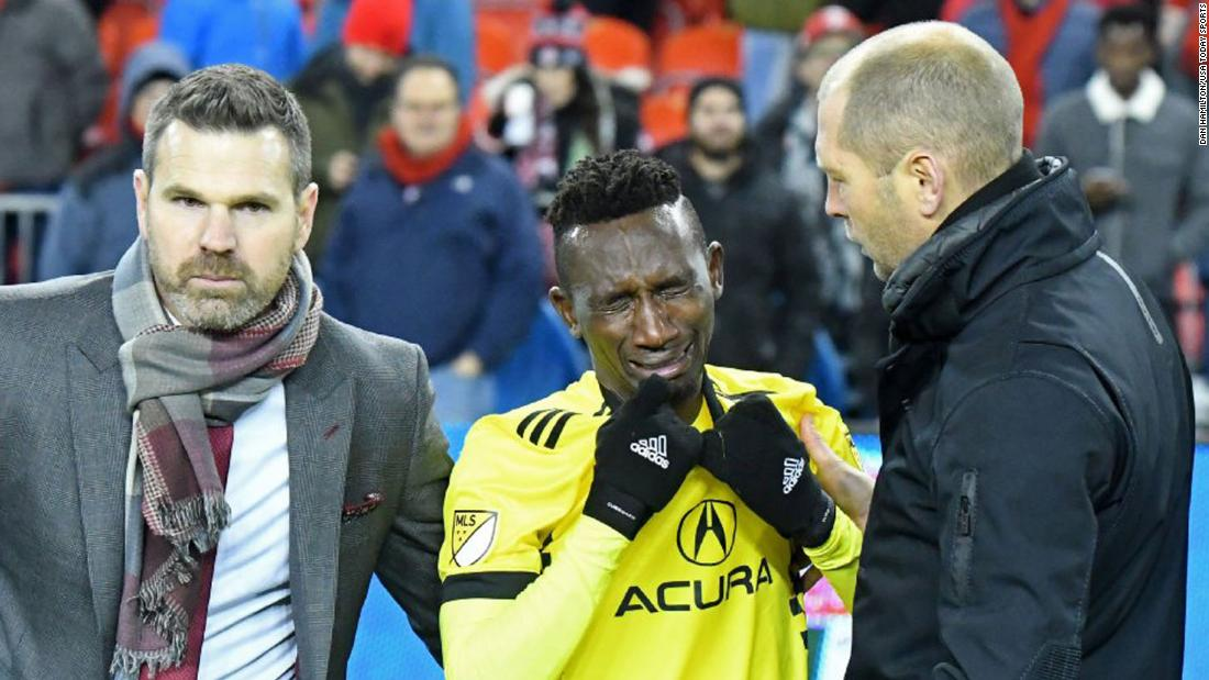 Columbus defender Harrison Afful is consoled by his coach, Gregg Berhalter, right, and Toronto coach Greg Vanney after Toronto won Major League Soccer's Eastern Conference Championship on Wednesday, November 29. Toronto will play Seattle in an MLS Cup rematch on December 10.