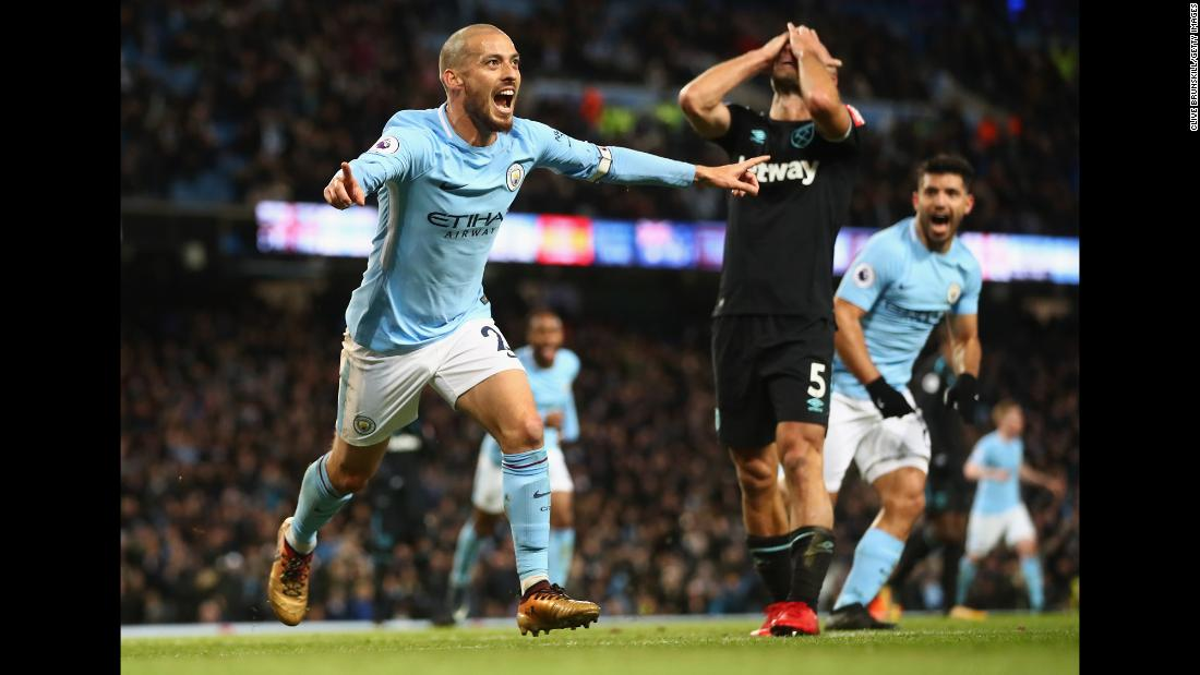Manchester City's David Silva celebrates his goal -- and West Ham's Pablo Zabaleta covers his face -- during a Premier League match in Manchester, England, on Sunday, December 3. Manchester City won 2-1 to maintain its eight-point lead in the league standings.