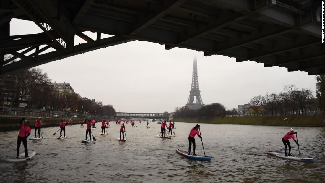 "Amateurs and professionals take part in a paddleboard race along the Seine river in Paris on Sunday, December 3. <a href=""http://www.cnn.com/2017/11/27/sport/gallery/what-a-shot-sports-1128/index.html"" target=""_blank"">See 23 amazing sports photos from last week</a>"