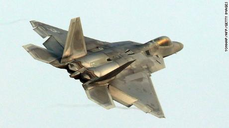 "A US Air Force F-22 Raptor stealth jet flies over a South Korean air base in Gwangju on December 4, 2017. The US and South Korea on December 4 kicked off their largest ever joint air exercise, an operation North Korea has labelled an ""all-out provocation"", days after Pyongyang fired its most powerful intercontinental ballistic missile. / AFP PHOTO / YONHAP / - /  - South Korea OUT / NO ARCHIVES -  RESTRICTED TO SUBSCRIPTION USE-/AFP/Getty Image"