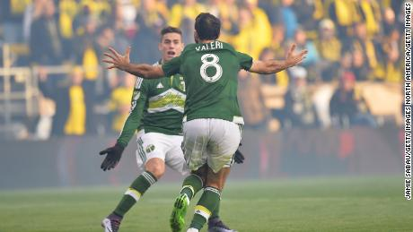 COLUMBUS, OH - DECEMBER 6:  Diego Valeri #8 of the Portland Timbers celebrates with Lucas Melano #26 of the Portland Timbers after scoring within the first minute of the first half against the Columbus Crew SC on December 6, 2015 at MAPFRE Stadium in Columbus, Ohio. Portland defeated Columbus Crew SC 2-1 to claim the MLS Cup title.  (Photo by Jamie Sabau/Getty Images)