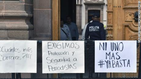 A policeman stands guard at the entrence of the government's palace during a  demonstration to demand justice for slain Mexican photojournalist Edgar Daniel Castro in San Luis Potosi, Mexico on October 6, 2017.  Castro was kidnapped from his house by gunmen and was found dead on Friday in San Luis Potosi. / AFP PHOTO / YURI CORTEZ        (Photo credit should read YURI CORTEZ/AFP/Getty Images)