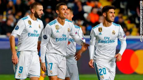 Real Madrid's Portuguese forward Cristiano Ronaldo (2nd-R) celebrates with teammates his first goal, and his team's fifth, during the UEFA Champions League Group H match between Apoel FC and Real Madrid on November 21, 2017, in the Cypriot capital Nicosia's GSP Stadium.  / AFP PHOTO / Jack GUEZ        (Photo credit should read JACK GUEZ/AFP/Getty Images)