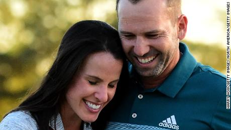 AUGUSTA, GA - APRIL 09:  Sergio Garcia of Spain embraces fiancee Angela Akins in celebration after defeating Justin Rose (not pictured) of England on the first playoff hole during the final round of the 2017 Masters Tournament at Augusta National Golf Club on April 9, 2017 in Augusta, Georgia.  (Photo by Harry How/Getty Images)